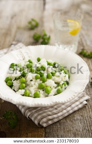 Risotto with peas - stock photo