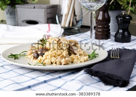 risotto with porcini mushrooms and cream sauce. Stock image. - stock photo