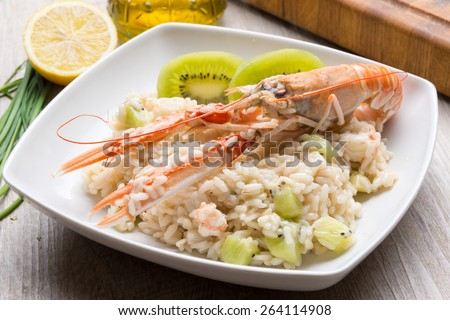 risotto with prawns and kiwi - stock photo