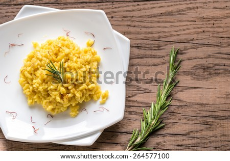 Risotto with saffron - stock photo