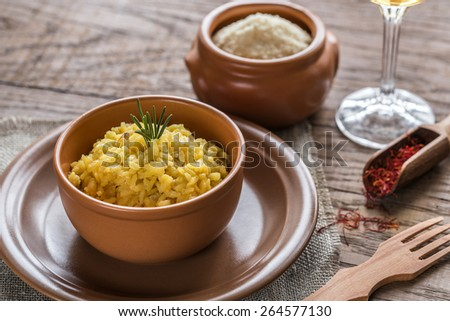 Risotto with saffron and parmesan - stock photo