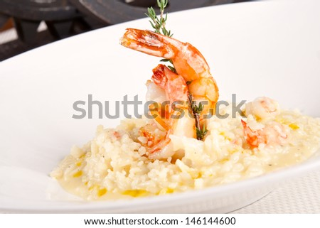 Risotto with shrimps - stock photo