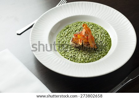 Risotto with spinach and scallop. - stock photo