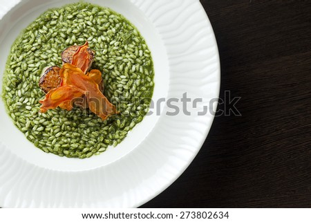 Risotto with spinach and scallop.Top view. - stock photo