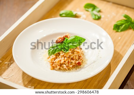 Risotto with sun-dried tomatoes and capers - stock photo