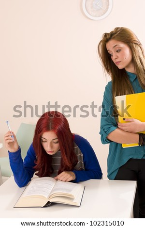 Rivalry between two females students - stock photo