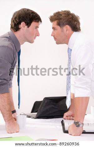 Rivalry between two workers - stock photo