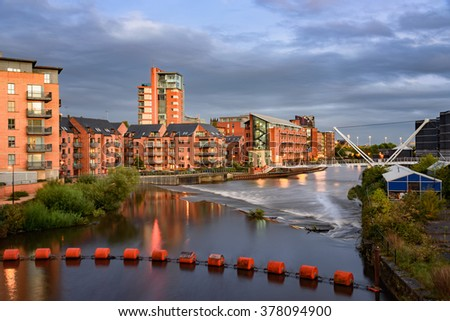 River Aire flowing through Clarence docks in Leeds, UK. - stock photo