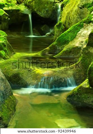 River amongst cascade. Bright natural landscape - stock photo