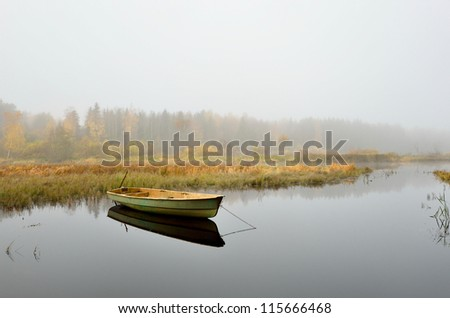river and a boat scene during Fall season - stock photo