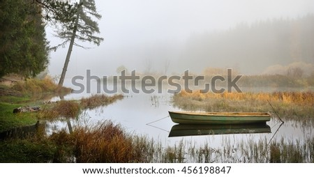 River and a boat scene during Fall season in Russia
