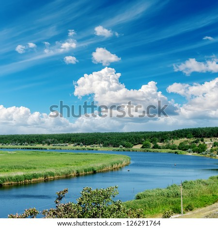 river and cloudy sky over it - stock photo