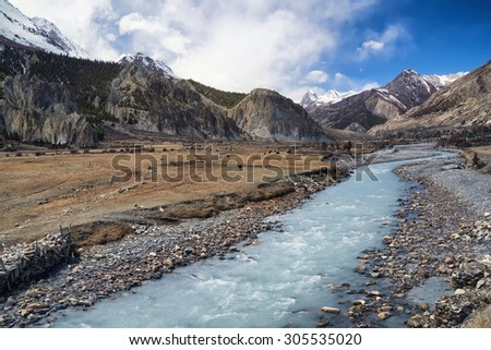 River and high mountains. Beautiful natural landscape - stock photo