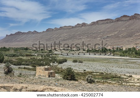 River and old berber village in Atlas mountains, Morocco - stock photo