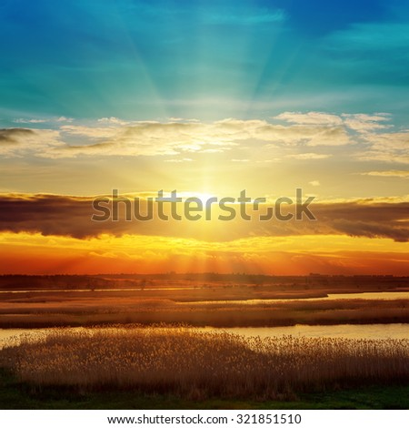 river and sunset in clouds - stock photo
