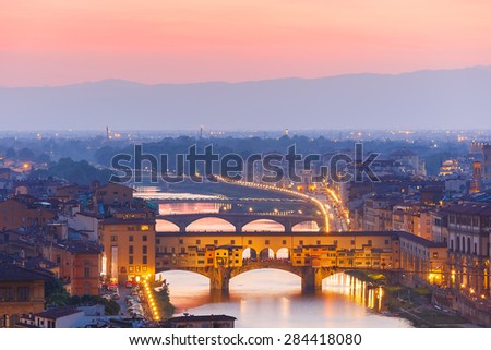 River Arno and famous bridge Ponte Vecchio at sunset from Piazzale Michelangelo in Florence, Tuscany, Italy - stock photo