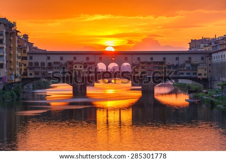 River Arno and famous bridge Ponte Vecchio at sunset from Ponte alle Grazie in Florence, Tuscany, Italy - stock photo