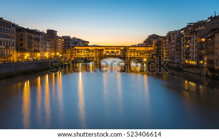 River Arno and Ponte Vecchio in Florence at sunset, Italy.