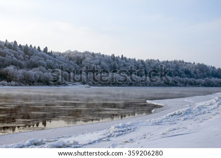 River at winter. Frost on trees in winter, nature landscape - stock photo
