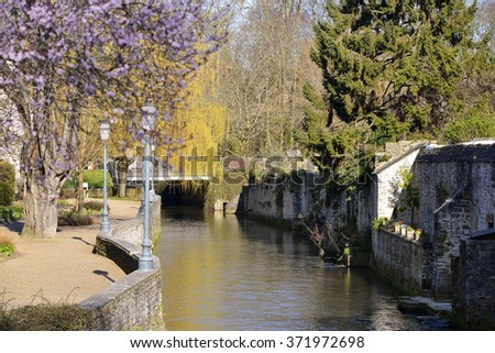 River Aure with trees in the town of Bayeux, a commune in the Calvados department in Normandy in northwestern France - stock photo