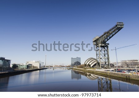 River Clyde in Glasgow with bridge, crane, auditorium and modern buildings