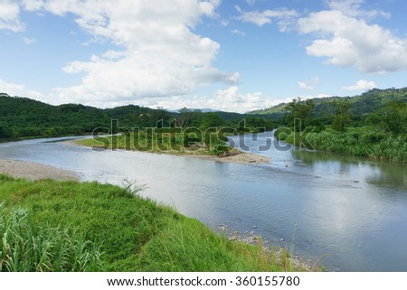 River confluence at Sabah Malaysian Borneo during cloudy blue sky. - stock photo