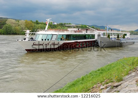 river cruising boat on river Danube in Austria - stock photo