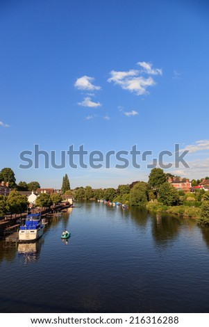 River Dee flowing past the historic town of Chester, England. - stock photo