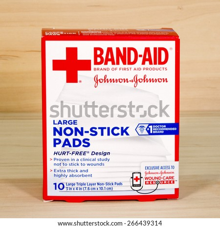 RIVER FALLS,WISCONSIN-APRIL3,2015: A box of Band-Aid brand large non-stick pads. This product is distributed by Johnson and Johnson of New Brunswick,New Jersey. - stock photo
