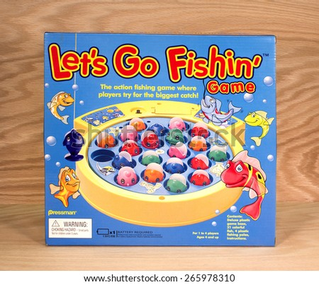 RIVER FALLS,WISCONSIN-APRIL 1,2015: A Lets Go Fishing game box by Pressman Toy Corporation. Pressman Toys was bought by Goliath Games in Twenty Fourteen. - stock photo