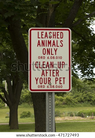 RIVER FALLS,WISCONSIN-AUGUST 19,2016: A sign indicating that people must clean up after their pets.