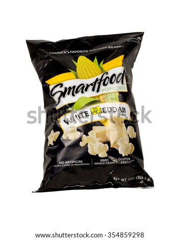 RIVER FALLS,WISCONSIN-DECEMBER 23,2015: A bag of Smart Food brand white cheddar popcorn. Smart Food products can be found at your local Dollar General store. - stock photo