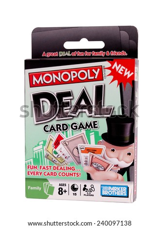 RIVER FALLS,WISCONSIN-DECEMBER 26,2014: Monopoly Deal card game from Parker Brothers. Parker Brothers have published more than Eighteen Hundred games. - stock photo