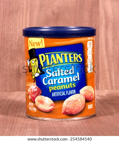 RIVER FALLS,WISCONSIN-FEBRUARY 21,2015: A can of Planters Salted Caramel peanuts. Planters is a division of Kraft Foods. - stock photo