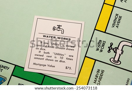 RIVER FALLS,WISCONSIN-FEBRUARY 18,2015: A closeup view of a Monopoly board featuring the Water Works card. - stock photo