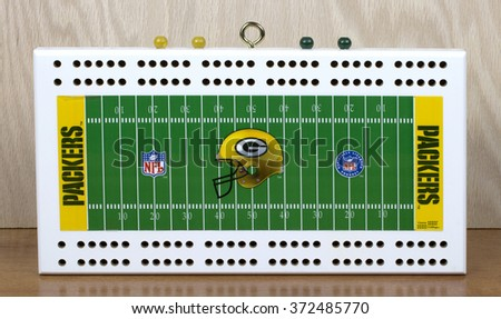 RIVER FALLS,WISCONSIN-FEBRUARY 05,2016: A Green Bay Packers cribbage board. The cribbage game goes back to the early Seventeenth century - stock photo