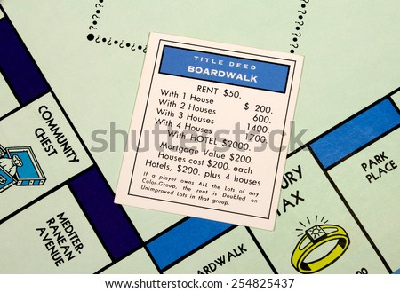 RIVER FALLS,WISCONSIN-FEBRUARY 22,2015: Closeup view of a Monopoly board featuring the Boardwalk card.