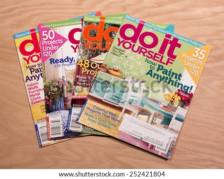 RIVER FALLS,WISCONSIN-FEBRUARY 13,2015: Four issues of Do It Yourself magazine. This magazine is published by Meredith National Media Group. - stock photo