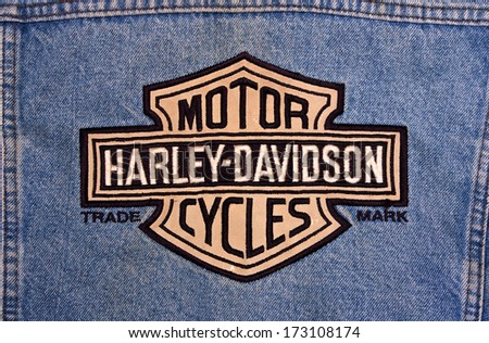 RIVER FALLS,WISCONSIN-JANUARY 25,2014: The Harley-Davidson logo on denim. Harley-Davidson was founded in Milwaukee, Wisconsin in 1903. - stock photo