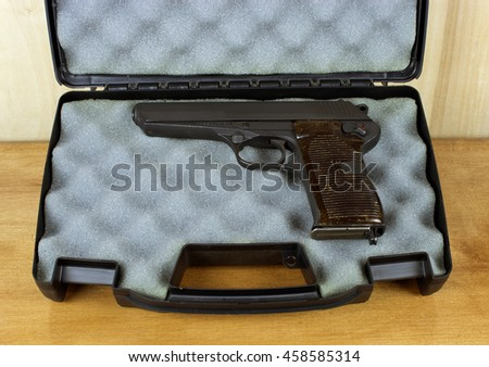 RIVER FALLS,WISCONSIN-JULY 25,2016: A vintage CZ52 semi-auto pistol in a padded case. - stock photo