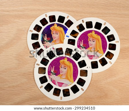 RIVER FALLS,WISCONSIN-JULY 23,2015: Three vintage Sleeping Beauty View-Master disks. Sleeping Beauty was produced by Walt Disney in Nineteen Fifty Nine. - stock photo