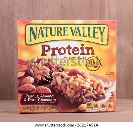 RIVER FALLS,WISCONSIN-MARCH 19,2015: A box of Nature Valley chewy protein bars. Nature Valley products are a brand  owned by General Mills Incorporated. - stock photo