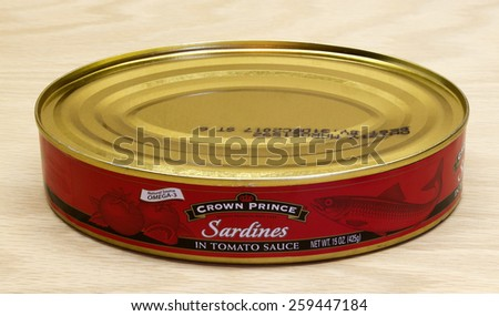 RIVER FALLS,WISCONSIN-MARCH 10,2015: A can of Crown Prince sardines in tomato sauce. Sardines are a good source of Omega-3. - stock photo
