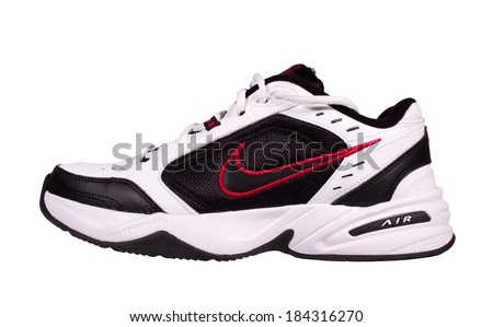 RIVER FALLS,WISCONSIN-MARCH 29, 2014: A single Nike athletic shoe with the famous Swoosh trademark. The Swoosh was created in Nineteen Seventy One by Carolyn Davidson. - stock photo