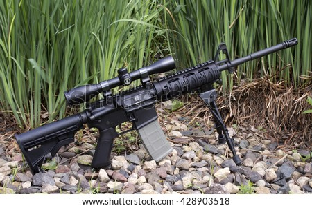 RIVER FALLS,WISCONSIN-MAY 29,2016: An AR-15 semi-auto rifle with Burris scope and tripod. - stock photo