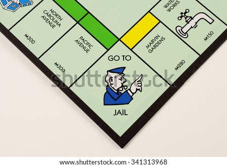 RIVER FALLS,WISCONSIN-NOVEMBER 07,2015: A closeup view of a Monopoly board featuring the Go To Jail square - stock photo