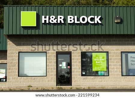 RIVER FALLS,WISCONSIN-OCTOBER 05,2014: An H&R Block storefront. H&R Block is a tax return preparation company with offices in the United States,Canada,Australia,Brazil and India. - stock photo