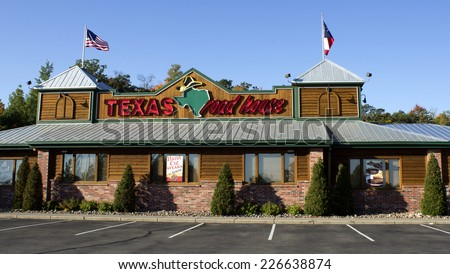RIVER FALLS, WISCONSIN - OCTOBER 27,2014: Exterior of a Texas Roadhouse restaurant. Texas Roadhouse was founded in 1993 in Clarksville,Indiana. - stock photo