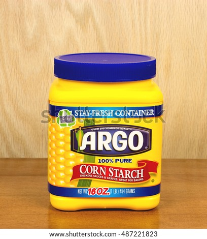 RIVER FALLS,WISCONSIN-SEPTEMBER 21,2016: A container of Argo brand corn starch against a wood background.