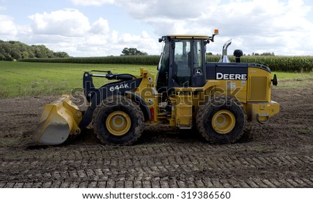 RIVER FALLS,WISCONSIN-SEPTEMBER22,2015: A large John Deere front end loader. Deere and Company is headquartered in Moline,Illinois. - stock photo
